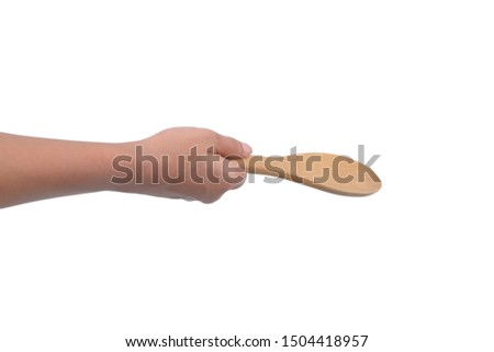 Asian female hands are holding Wooden ladle isolated on white isolated on white background with clipping path #1504418957