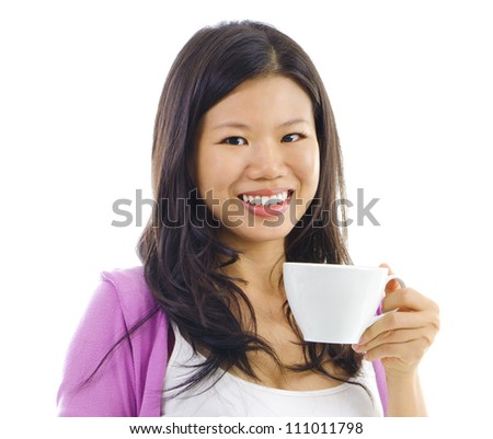 Asian female holding a tea cup over white background
