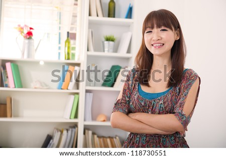 asian female on a living room