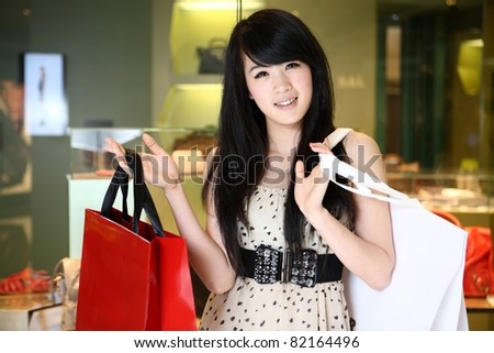 asian female shopping in mall