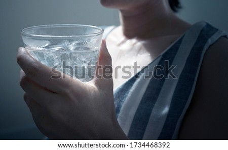 asian female thirsty and drinking water for protect dehydrated at Hot season