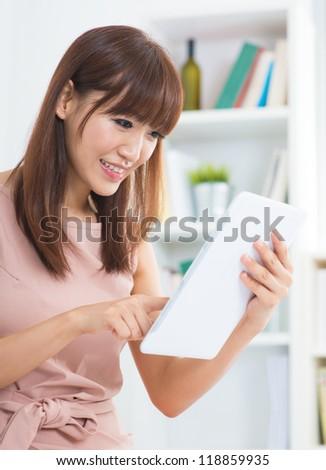 Asian female using digital tablet computer