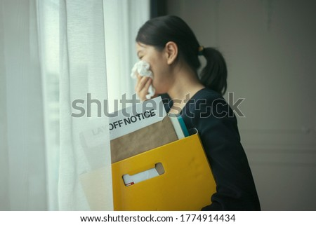 asian female very sad and she get layoff notice from company after Covid-19 lockdown Stock photo ©