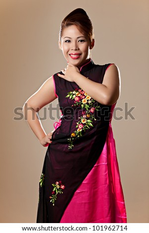 Asian Female Wearing a Traditional Pink Vietnamese Dress