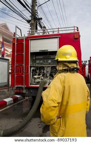 Asian Fireman with firetruck