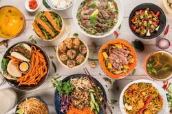 Asian food background with various ingredients on rustic wooden background , top view. Vietnam or Thai cuisine.