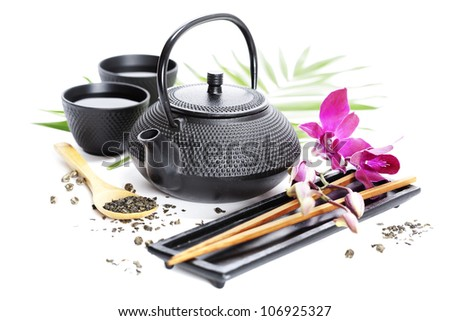 Asian food concept (Green tea, orchid and chopsticks)