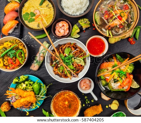 Asian food served on black stone, top view. Chinese and vietnamese cuisine set.