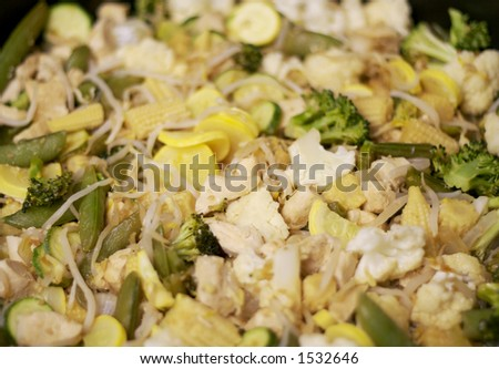 Asian Food: Stir-Fry with Chicken and Vegetables in a Wok.