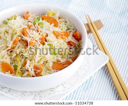 Asian fried rice noodles. Serve with chopsticks.