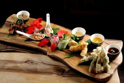 Asian Fusion appetizer plate, with Tempura, Shrimps, Spring rolls and spicy chicken