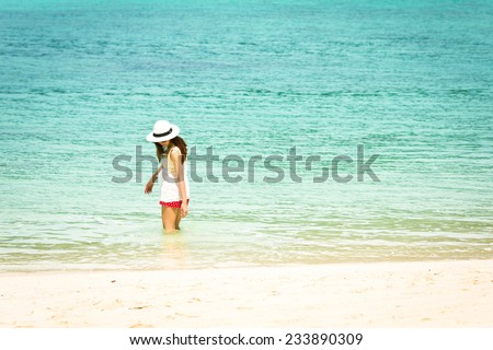 Asian girl and beautiful beach and sea, Lipe island, Andaman sea, Thailand.