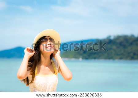 Asian girl and sea, Lipe island, Andaman sea, Thailand.