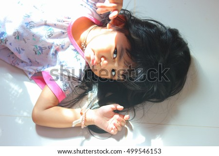 Asian girl child suffering insomnia cannot sleep. #499546153