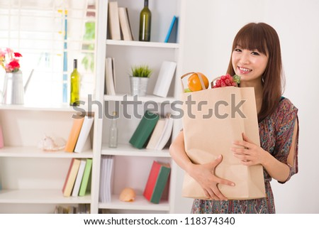 asian girl coming back from a shopping