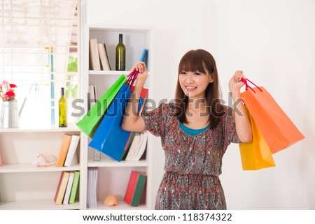 asian girl coming back from a shopping fair