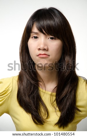 Asian girl does an angry face