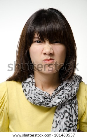 Asian girl does an angry face #101480557