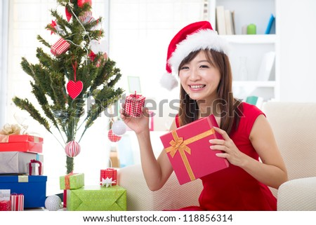 asian girl during christmas happily with her gifts