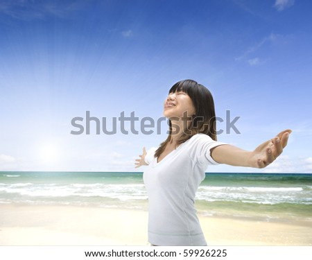 asian girl freedom relaxation concept photo on a beach - Shutterstock ID 59926225