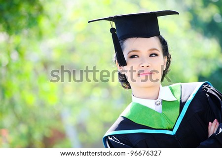 Asian girl graduation looking up outdoors