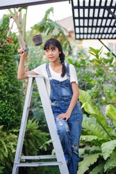 Asian girl holding a paintbrush for painting isolated and Climb the ladder