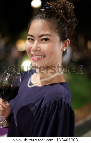 Asian Girl Holding Wine