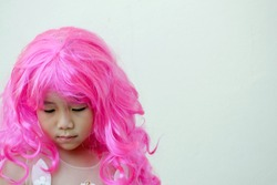 Asian girl in a pink wig,cosplay theme with a copy space