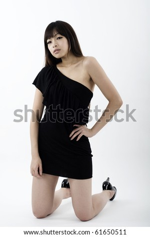 Asian girl in black clubbing dress