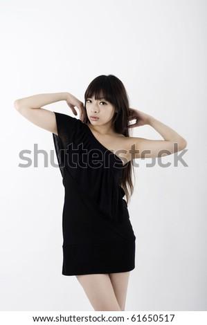 Asian girl in black clubbing dress dancing