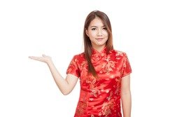 Asian girl in chinese cheongsam dress present blank space with her hand  isolated on white background