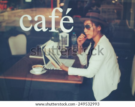Asian girl in coffee shop vintage color art filter tone style