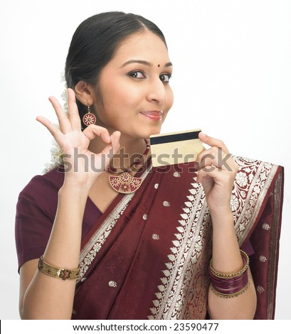 Asian girl in red silk sari with credit-card