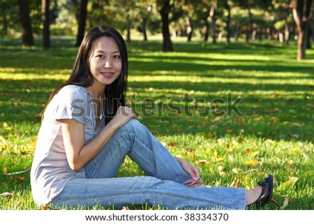 Asian girl in the park in the autumn
