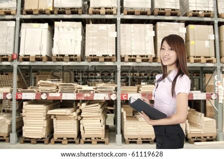 asian girl inside a warehouse - stock photo