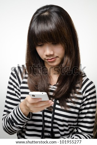 Asian girl is checking her smartphone
