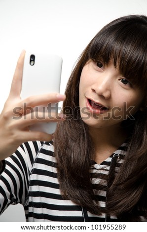 Asian girl is taking her photo with the smartphone