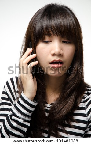Asian girl is using a smartphone