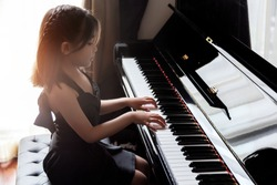 asian girl kids practice play piano for up skill of music ability for future occupation.