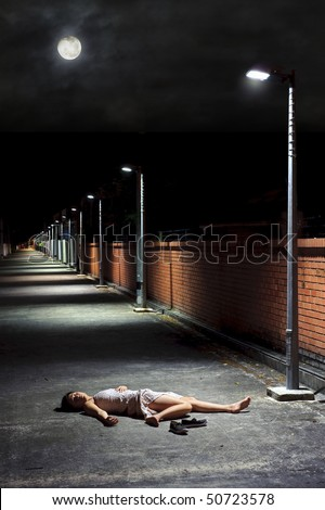 Asian girl lies in an empty street
