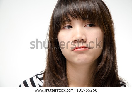 Asian girl making a bored face