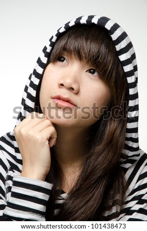 Asian girl on black and white shirt is thinking