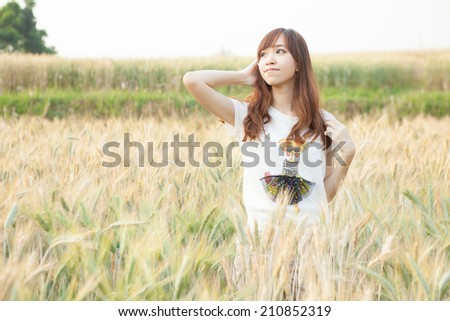 Asian girl on meadow