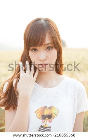 Asian girl on meadow