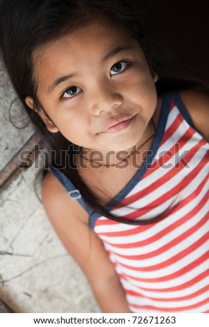 Asian girl portrait - Filipina against wall in natural light
