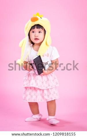 Asian Baby Girl Sitting On The Floor Isolated On White Backgrounds
