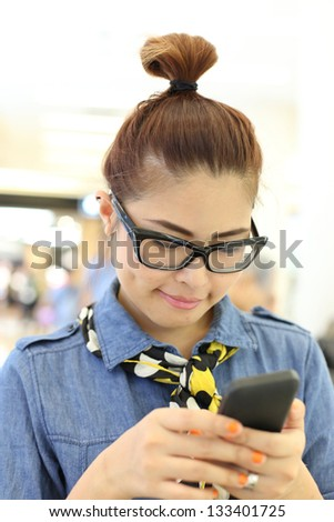 Asian Girl Reading Message from her Mobile