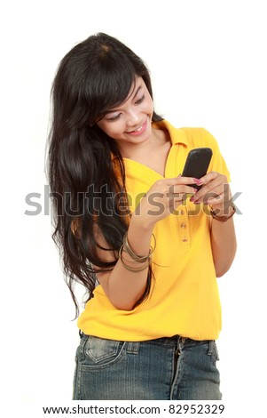 asian girl receiving text message. isolated over white background