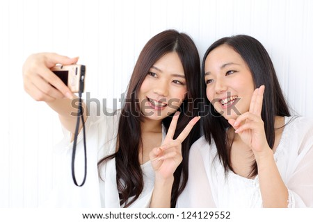 Asian girl self photographing