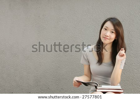 Asian Girl Student With a Textured Backdrop